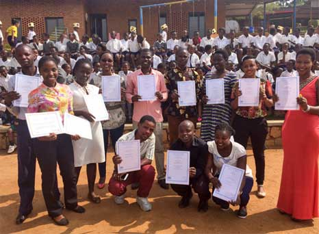 Group photo of class with certificates